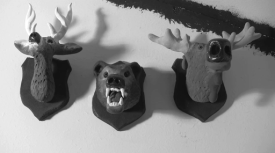 "Head mounts from undergrad film ""The Trophy Collector"". The heads are made out of baked Sculpey."